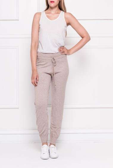 Knit trousers with pockets, elastic waist with tie to knot, tightened ankles