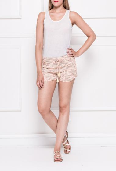Short with elastic waist and tie with pompons, pockets