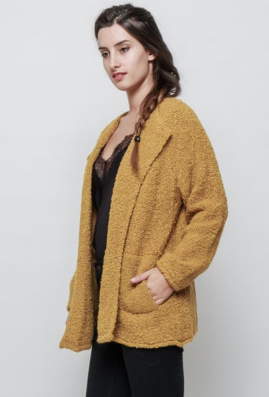 Knitted jacket, open front, casual fit, pockets. The model measures 176cm, one size corresponds to 38/40