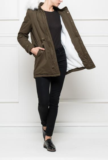Coat like parka with pockets and drawstring, removable hood decorated with fake fur