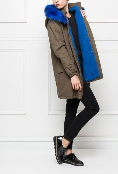 Zippered coat with flap pockets and drawstrings, inside in fleece, removable hood decorated with fake fur