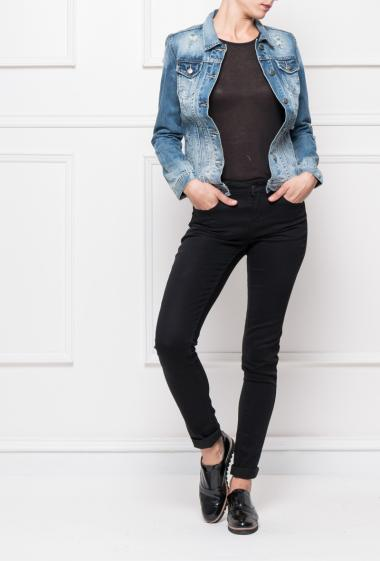 Buttoned jacket in faded and worn denim with pockets
