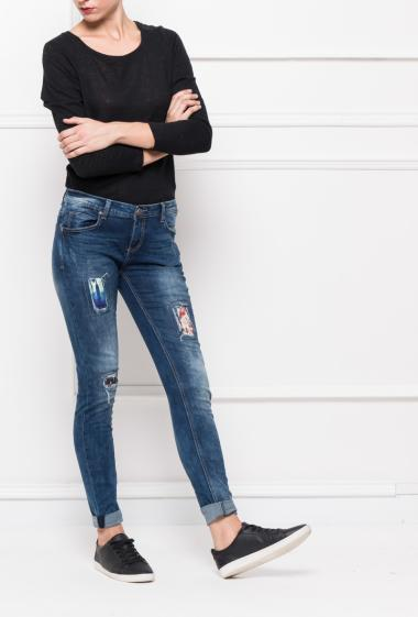 Faded jeans with rips and printed yokes, slim fit