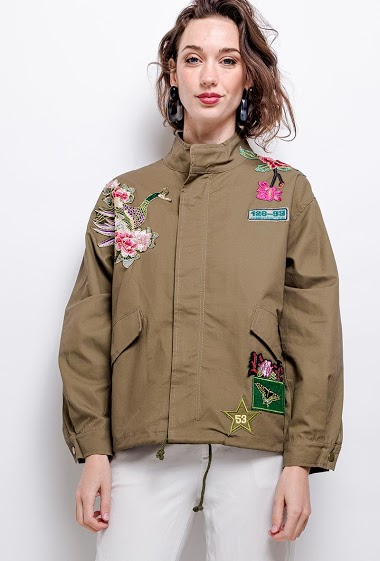 Parka with embroidered flowers. The model measures 177 cm