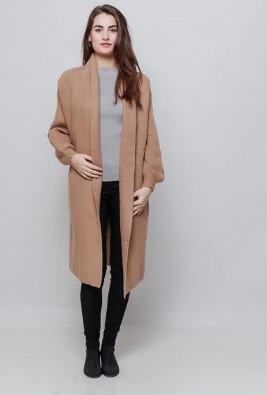 Long cardigan, open front, pockets. The model measures 172cm, one size corresponds to 38-40
