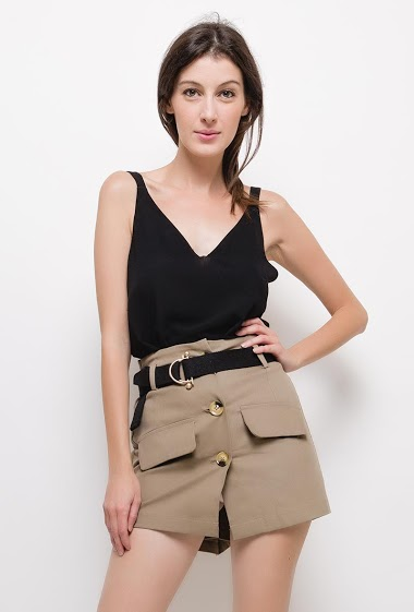 Buttoned short skirt,The model measures 178cm and wears S