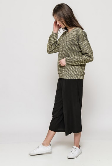 The model measures 172cm and wears S/M. Length:60cm