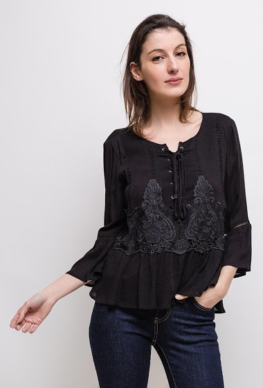 Blouse with applied flowers