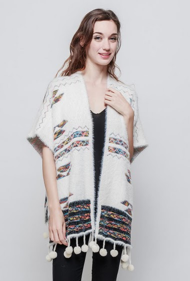 Fluffy poncho, border with pompons. The model measures 177 cm and wears S/M - Brand EXTELLE