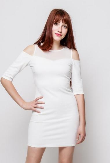Bi-material patterned dress, transparent tulle yoke, cold shoulder design, close fit, stretch fabbric. The model measures 174cm, one size corresponds to 38-40
