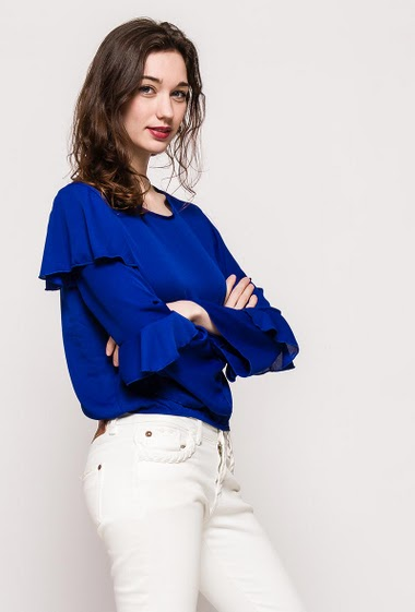 Crop blouse, elastic waist, long sleeves. The model measures 177cm, one size corresponds to 10/12. Length:49cm