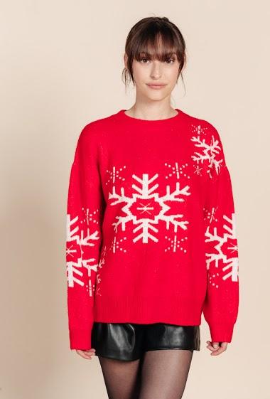 Pull femme avec motif flocon de neige, col rond, manches longues. La mannequin mesure 172 cm et porte du S.