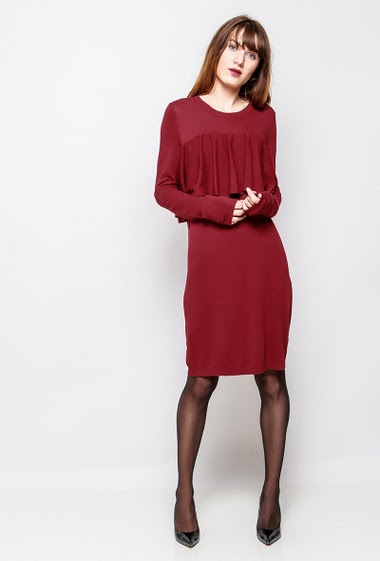 Dress with long sleeves, ruffles. The model measures 178cm and wears S/M