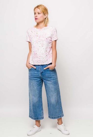 T-shirt à manches courtes. La mannequin mesure 177cm et porte du S. Longueur:58cm