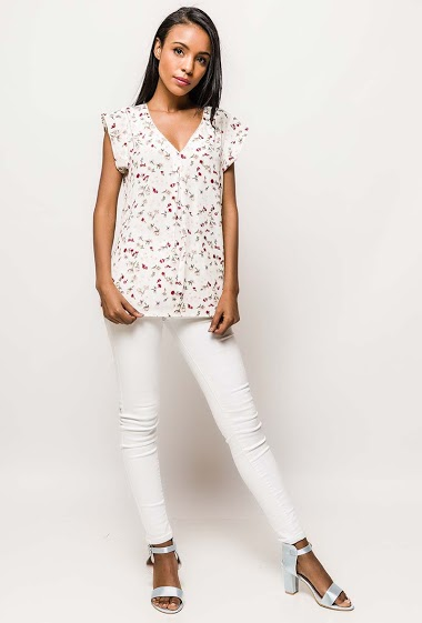 Short sleeve blouse, printed flowers. The model measures 172cm and wears S. Length:65cm