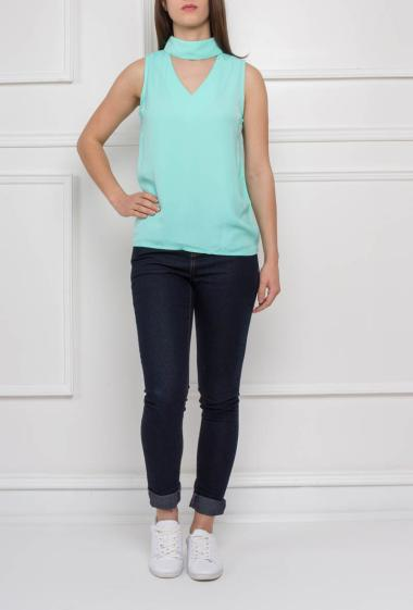 Top with stand-up collar, back zipper, sleeveless
