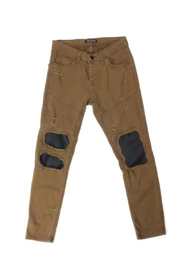 Ripped trousers with contrasting yokes in imitation leather