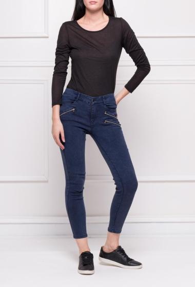 Slim trousers with pockets and fancy zips