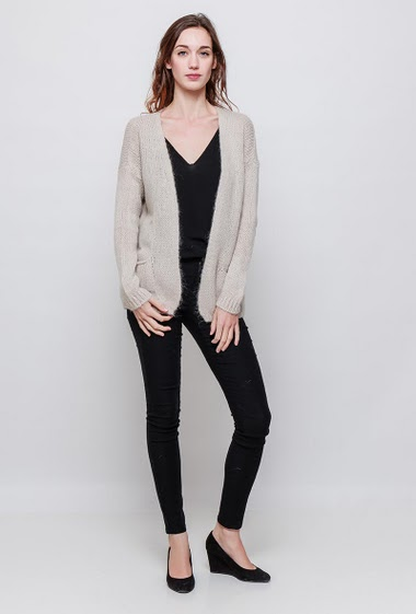 Open knitted cardigan, pockets, casual fit. The model measures 177cm, one size corresponds to 38-40