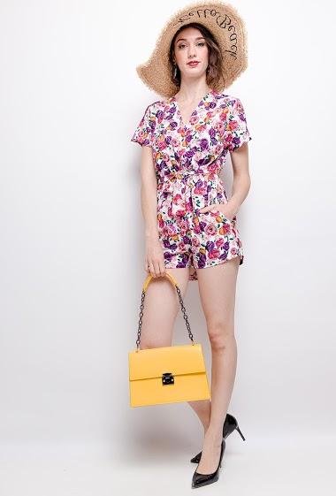 Wrap playsuit, printed flowers, short sleeves. The model measures 177 cm
