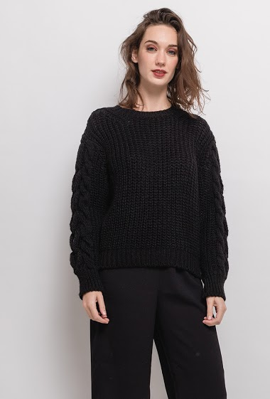 Sweater with twisted sleeves