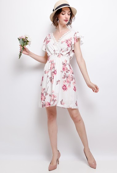 Wrap dress with printed flowers. The model measures 177 cm