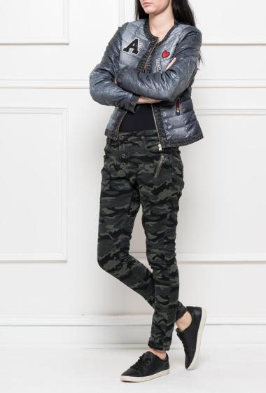 Military trousers, pockets decorated with zip