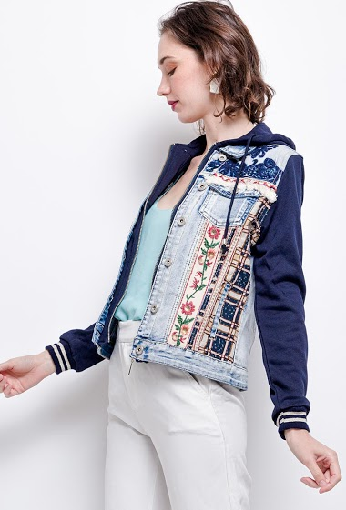 Bi-material jacket with embroidery. The model measures 177cm