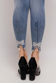 REDIAL skinny jeans with rhinestone bow