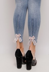 REDIAL skinny jeans with bow and rhinestones