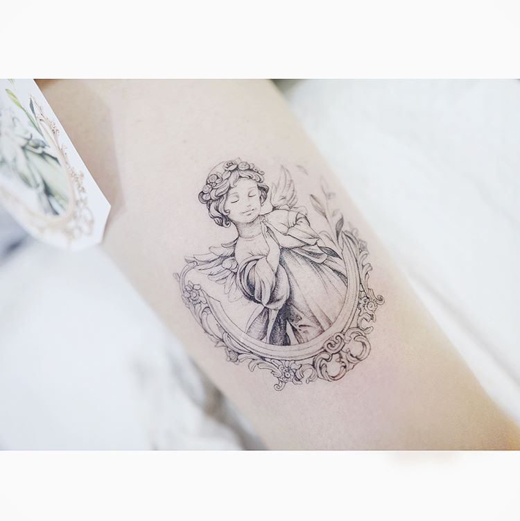 Angel tattoo of a cherub by Banul