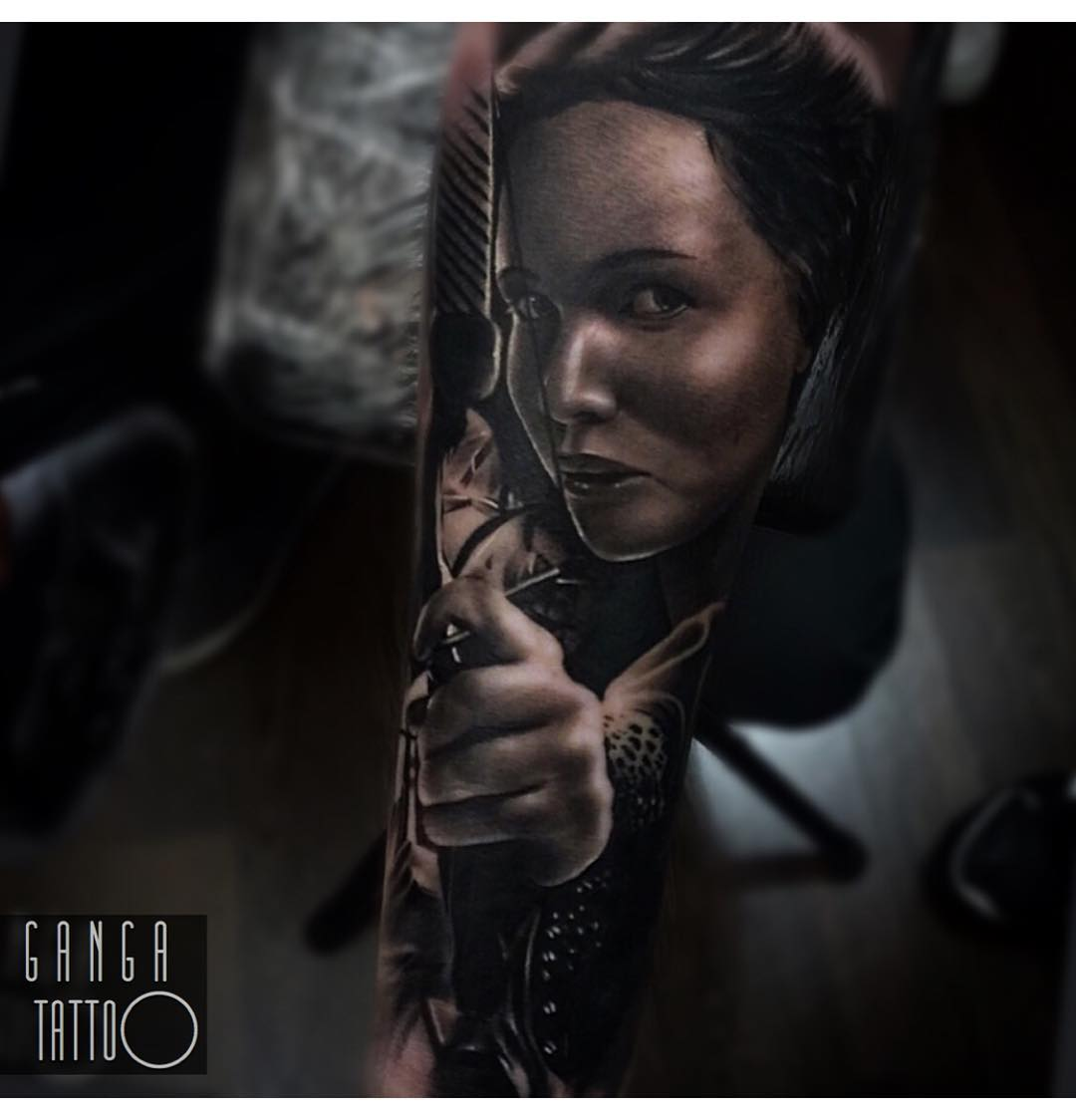 Book lovers tattoo of Katniss from Hunger Games