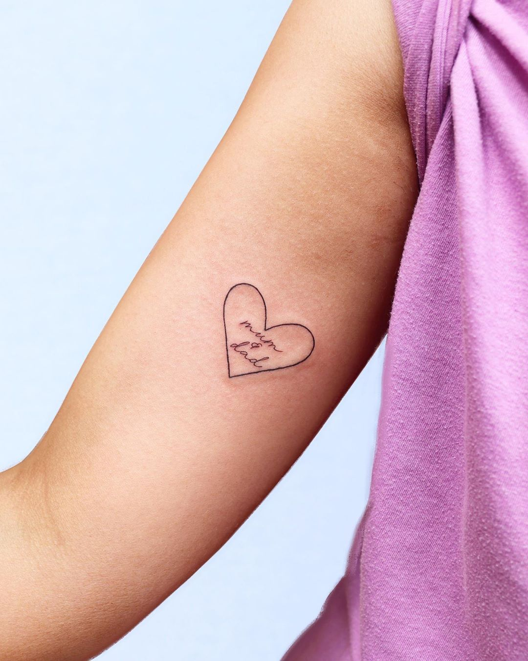 Family tattoo of mom dad in a heart by Zaya