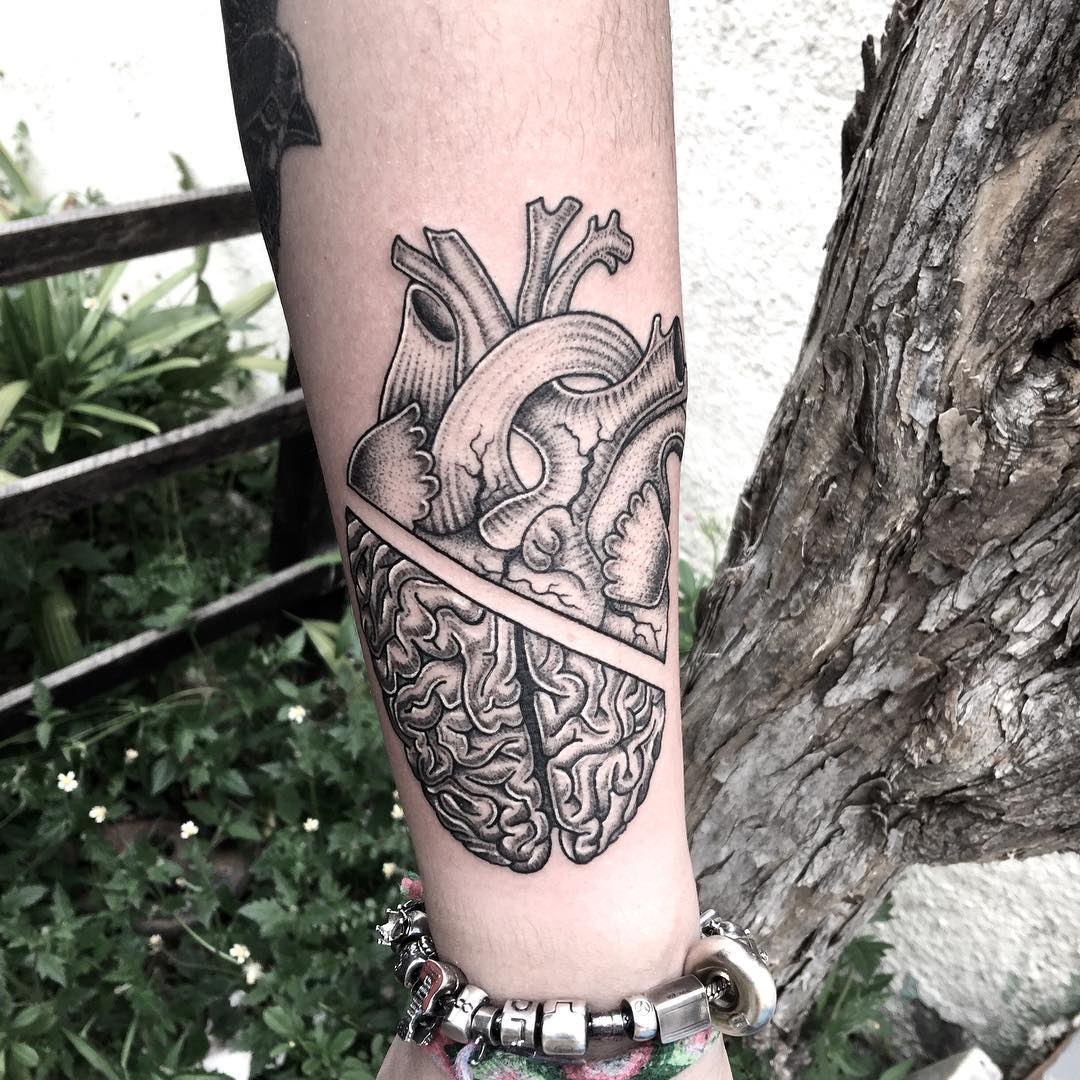 Heart tattoo by Rapha Lopes