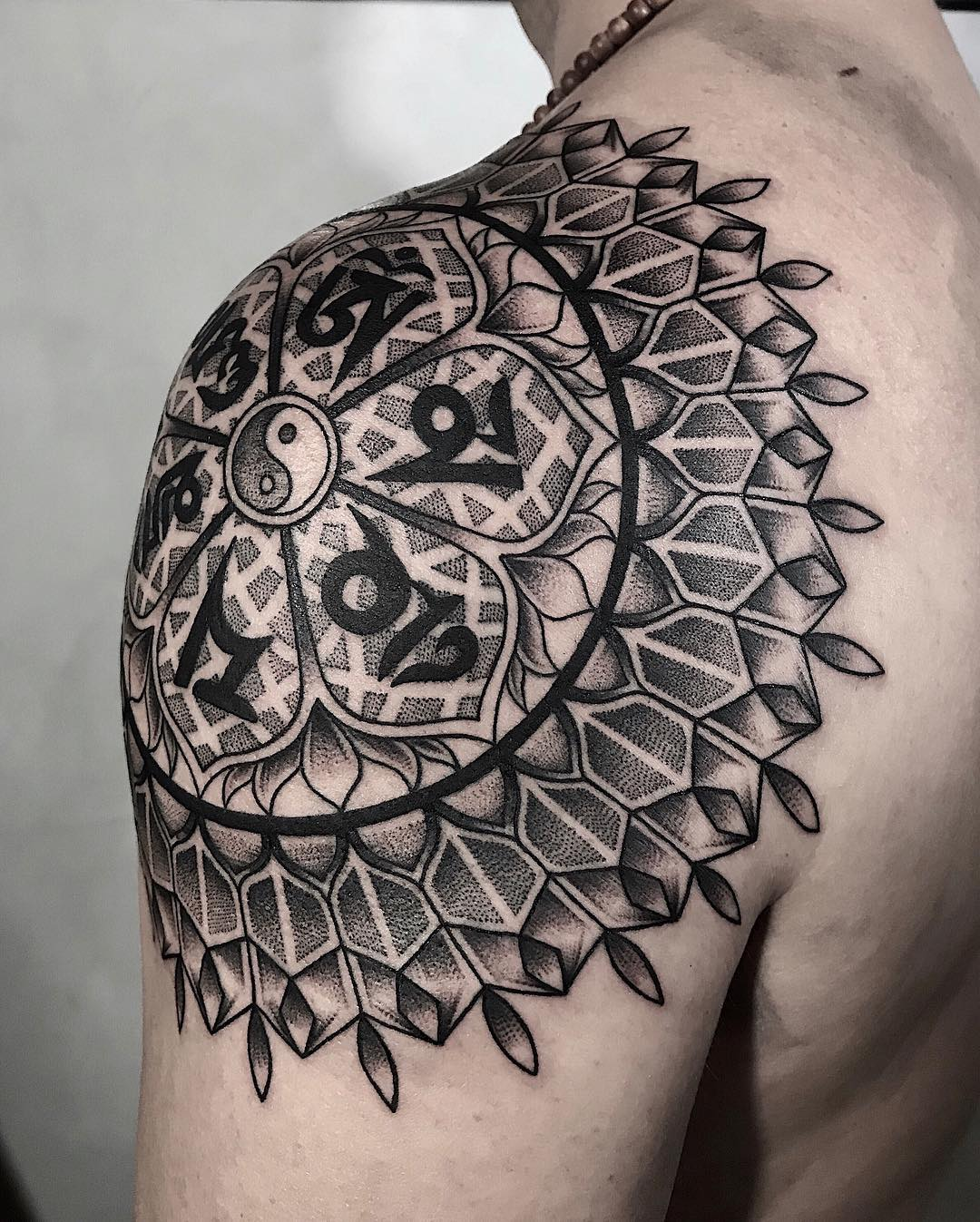 Sacred geometry shoulder tattoo from raphafons