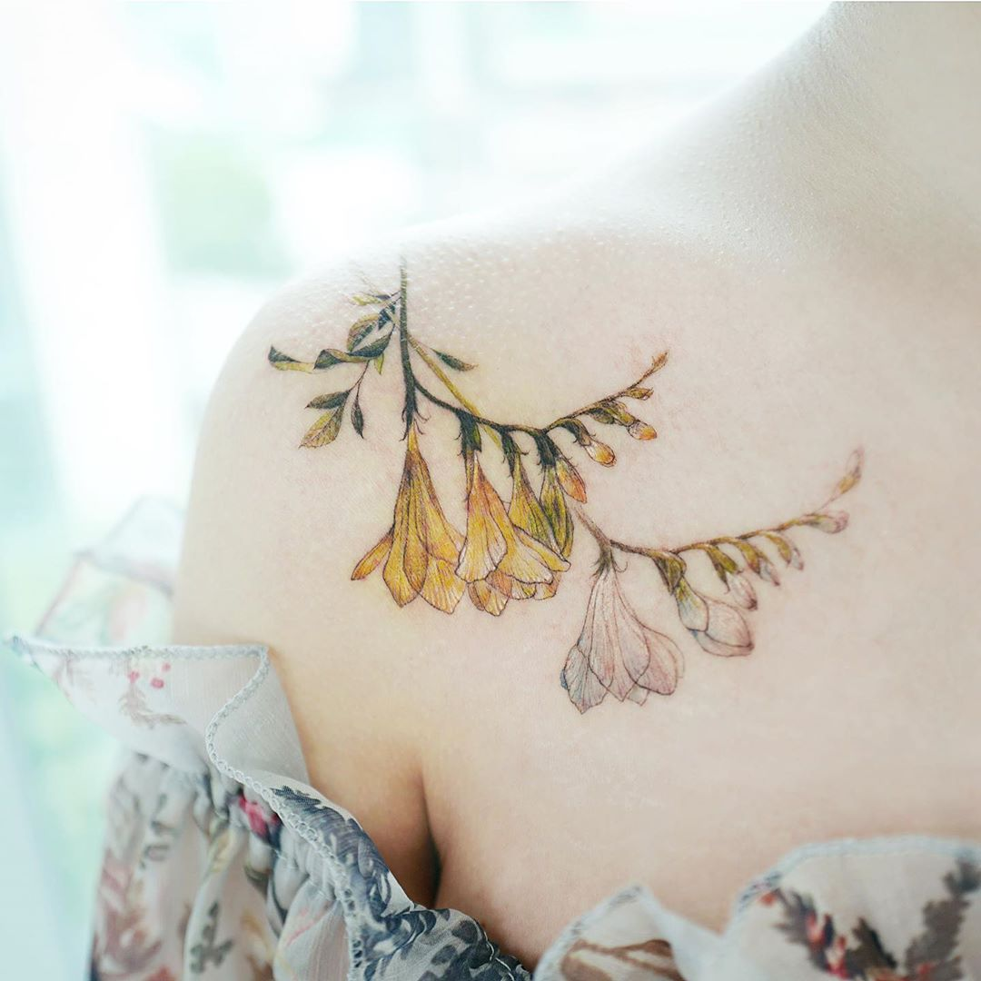 Floral shoulder tattoo from tattooist_banul