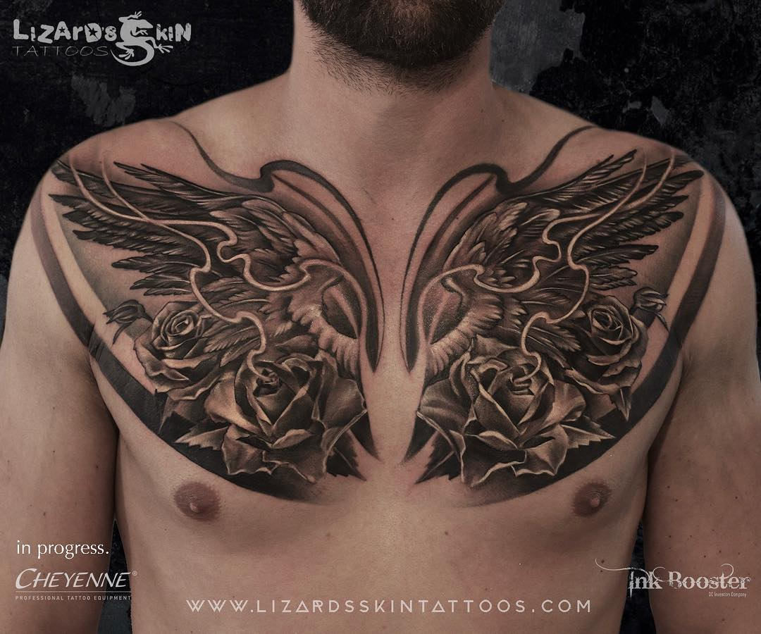 Wing tattoo on the chest by Niloy Das