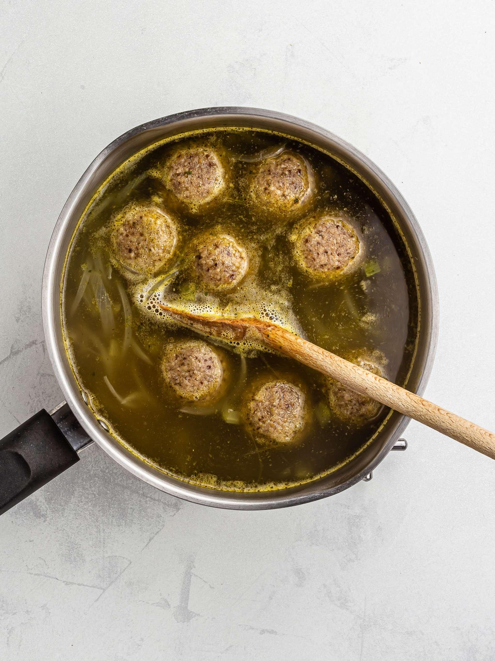 cooking matzo balls in a soup