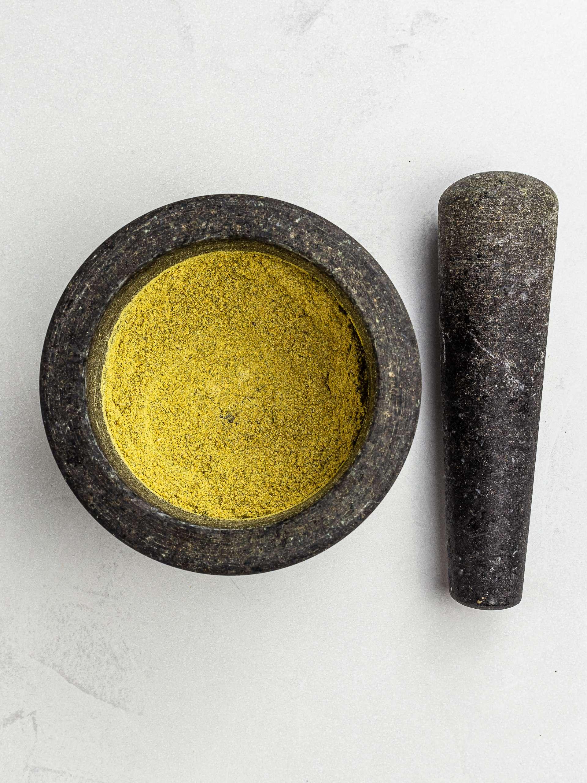 homemade bouillon powder in a mortar