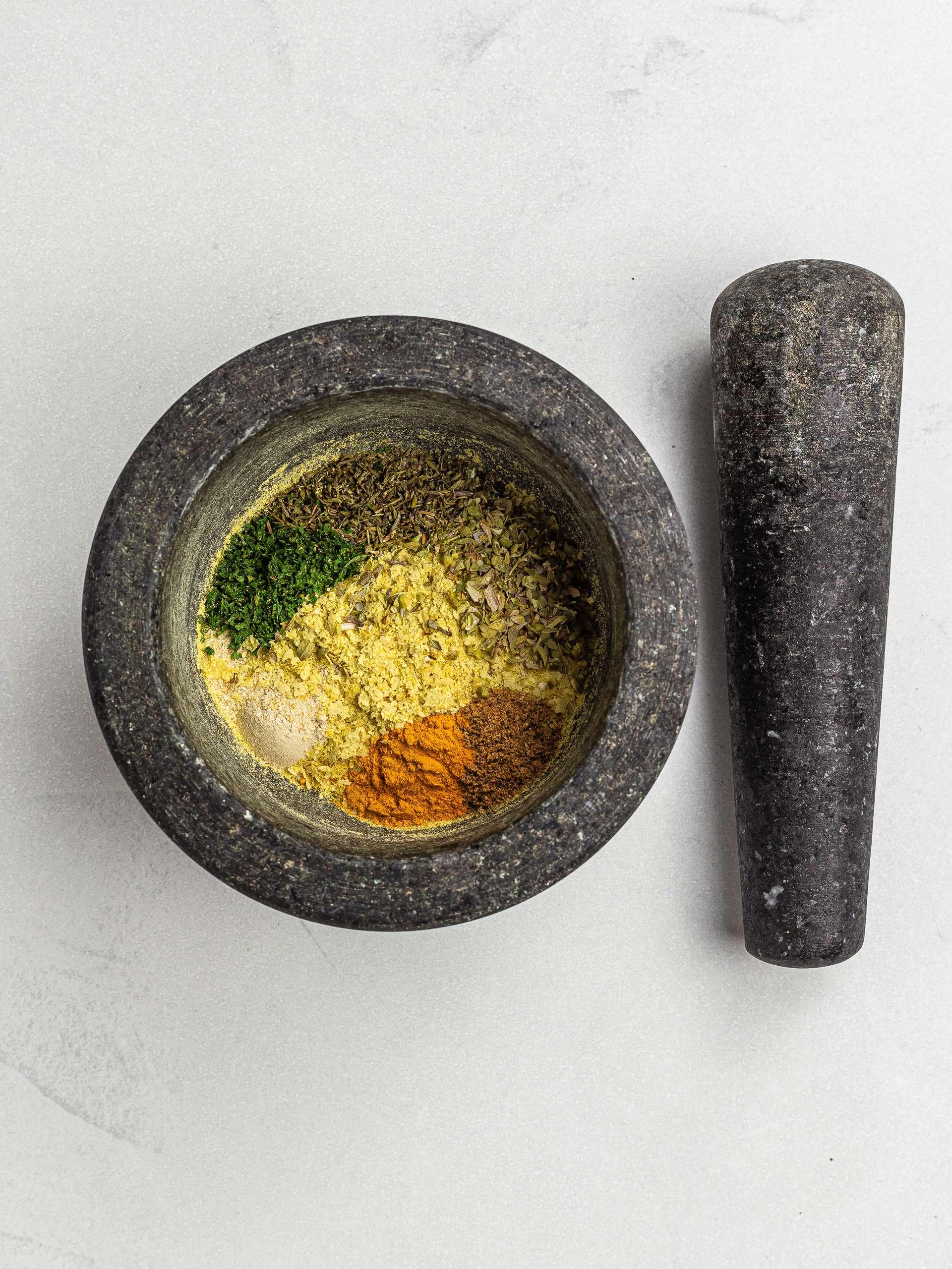 vegan bouillon power ingredients in a mortar