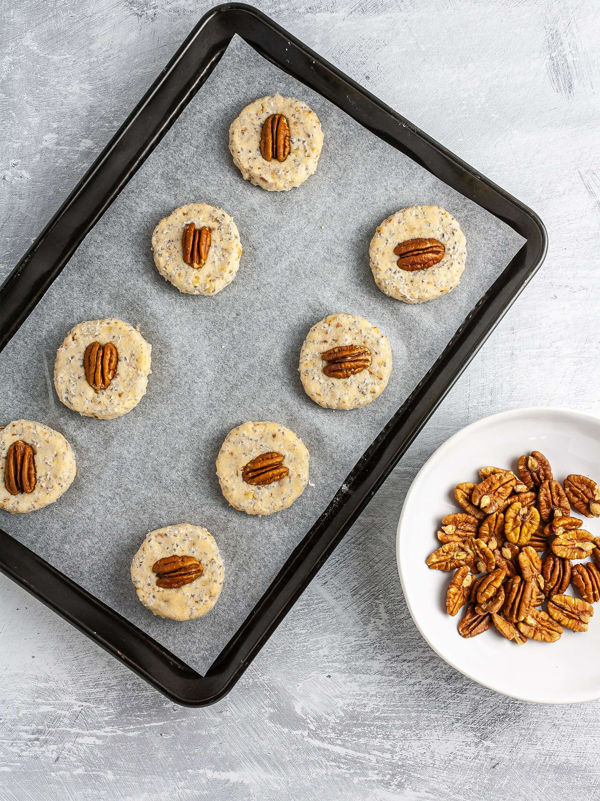 Shaped sandies topped with pecan nuts