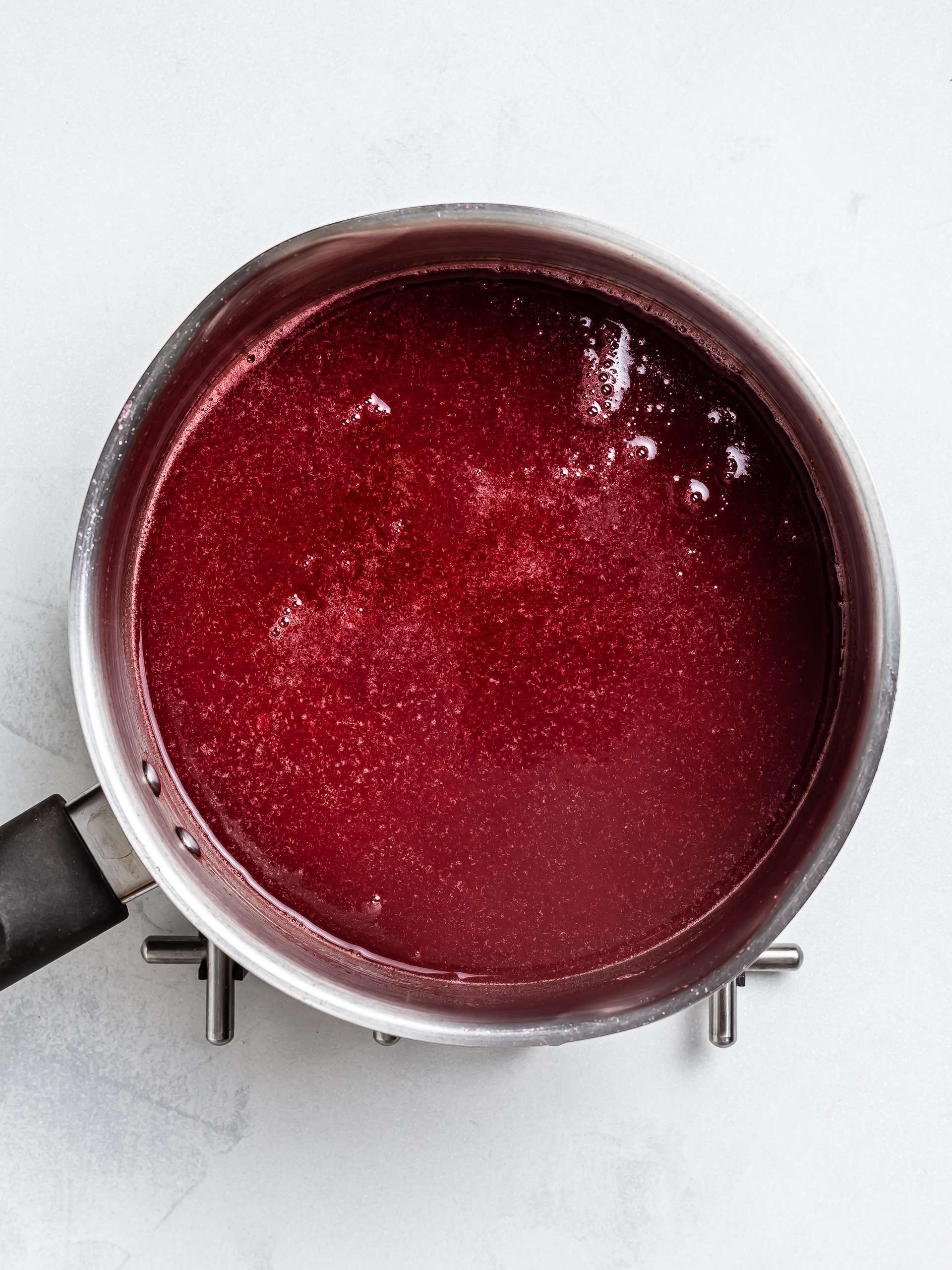 apple raspberry jam cooking in a pot