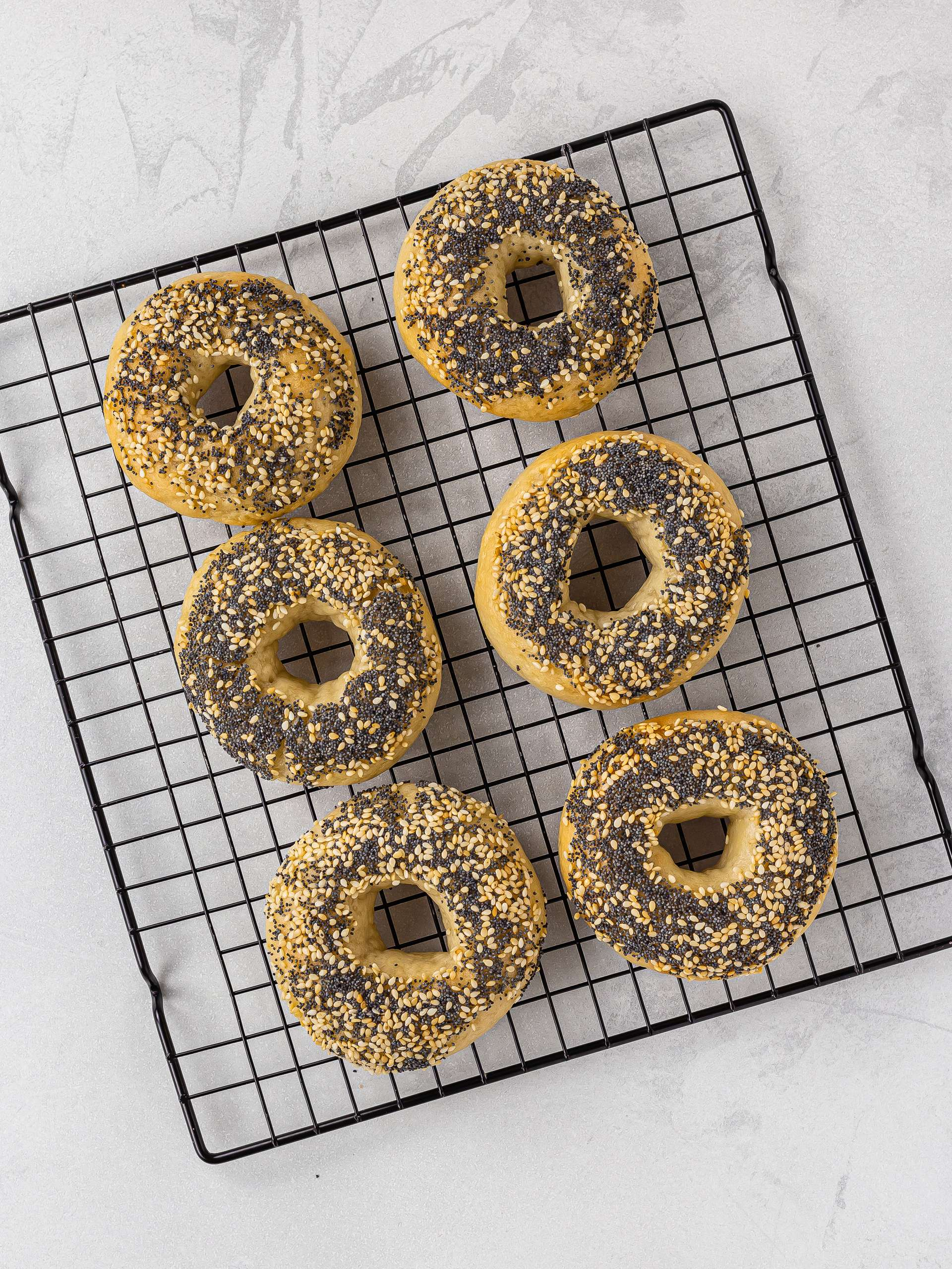 baked gluten free bagels on a rack
