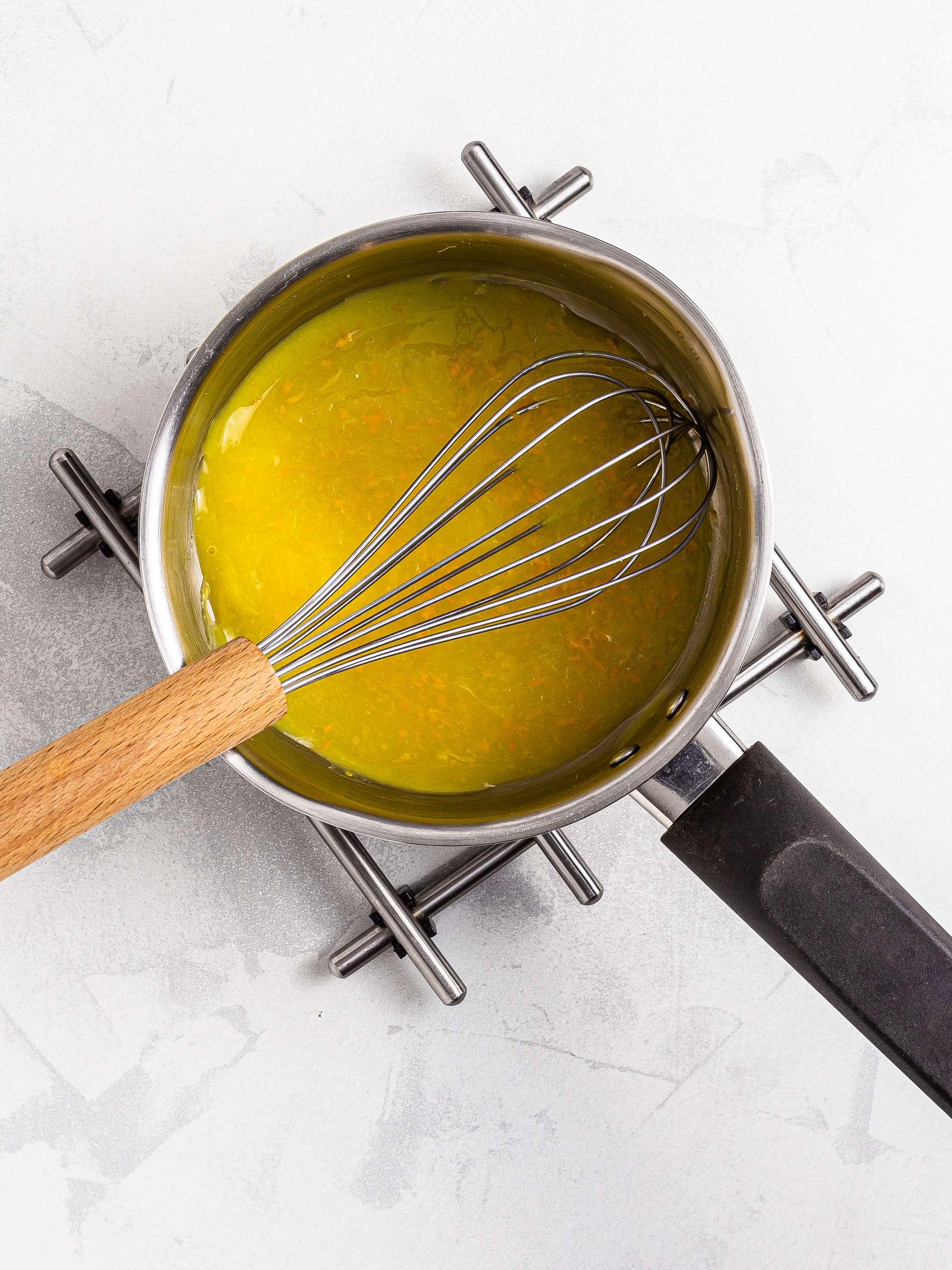 orange sauce in pot