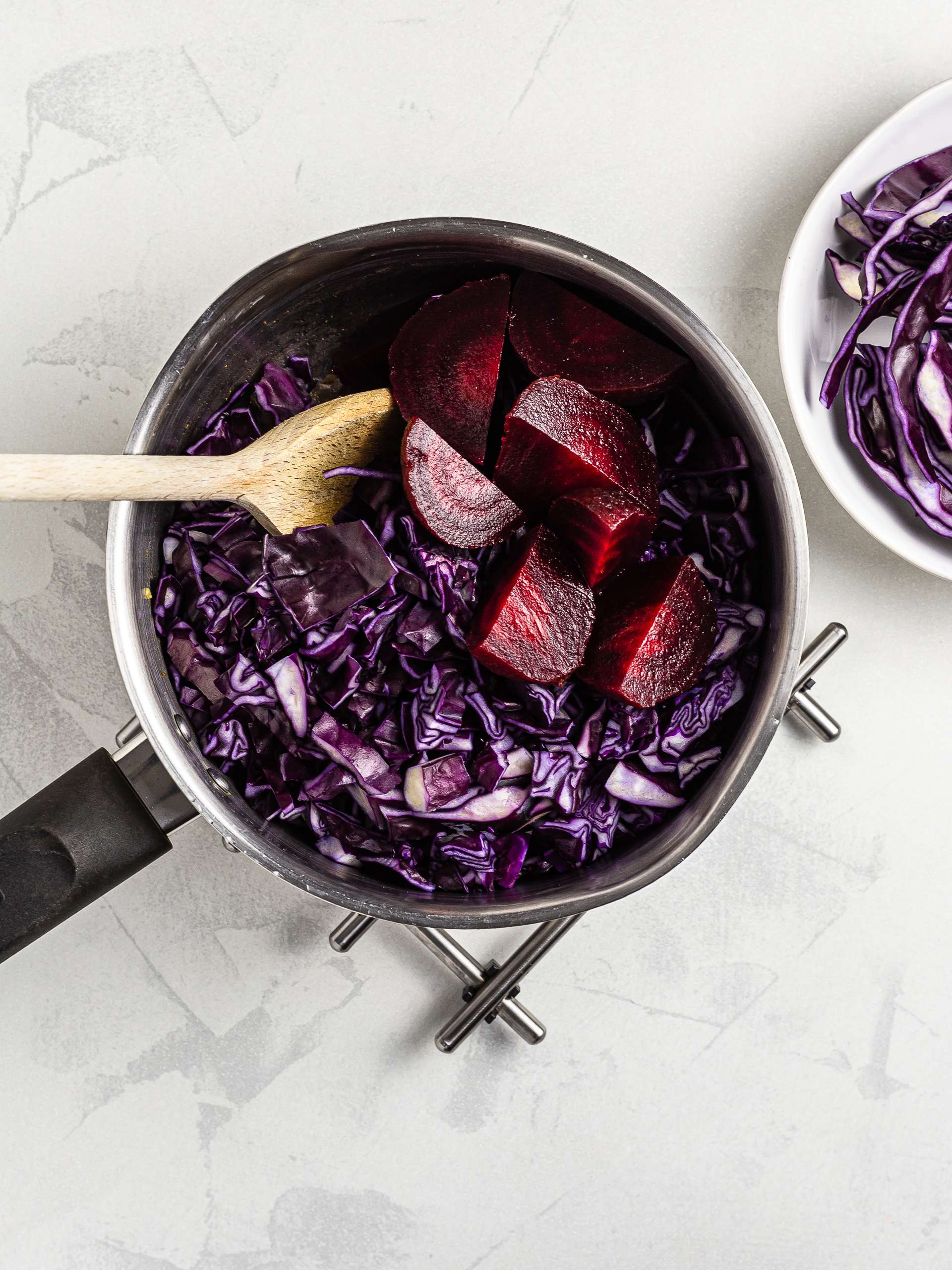 Red cabbage and beetroots in a pot for soup