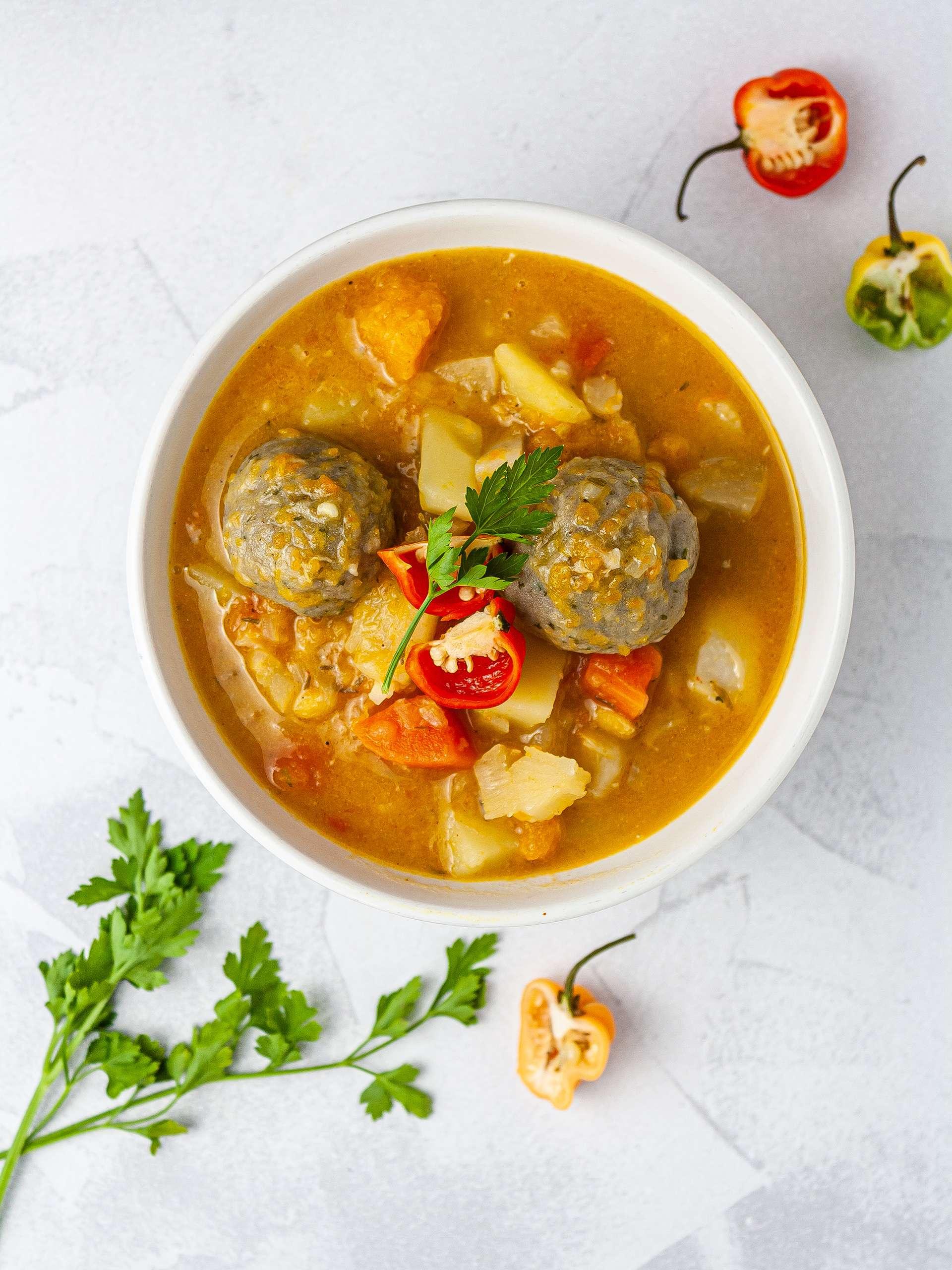Jamaican vegetable soup with scotch bonnet chillies.
