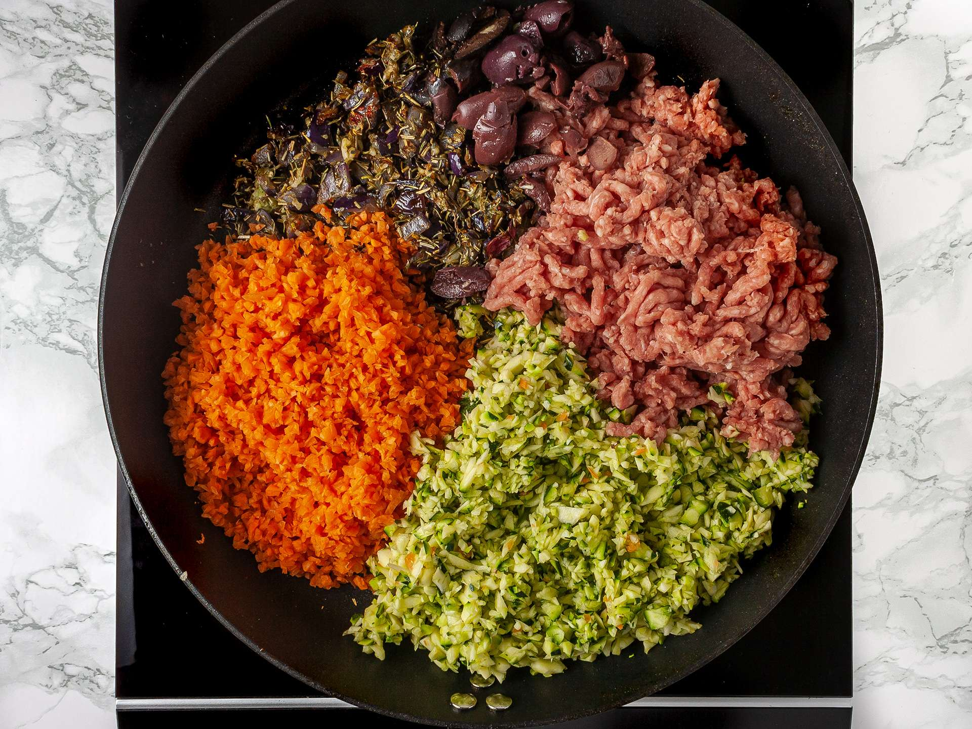 Lamb mince and grated vegetables in a skillet