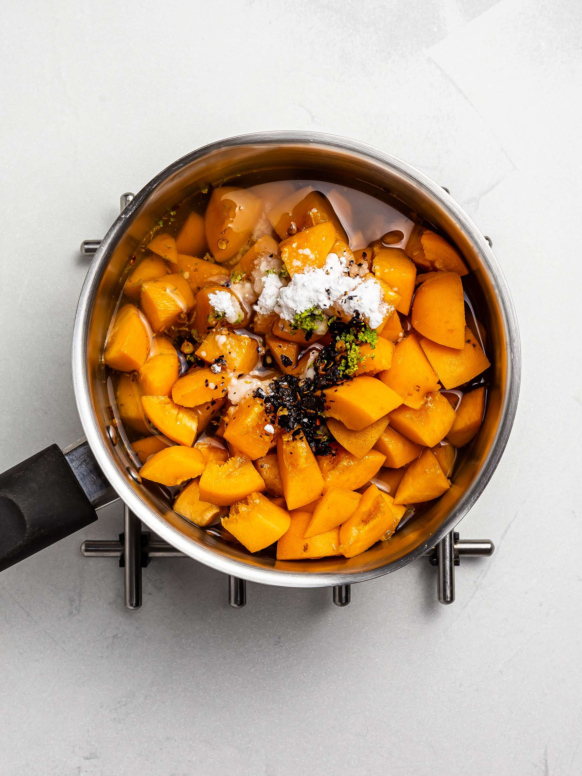 apricots lime and chillies in a pot for chamoy sauce
