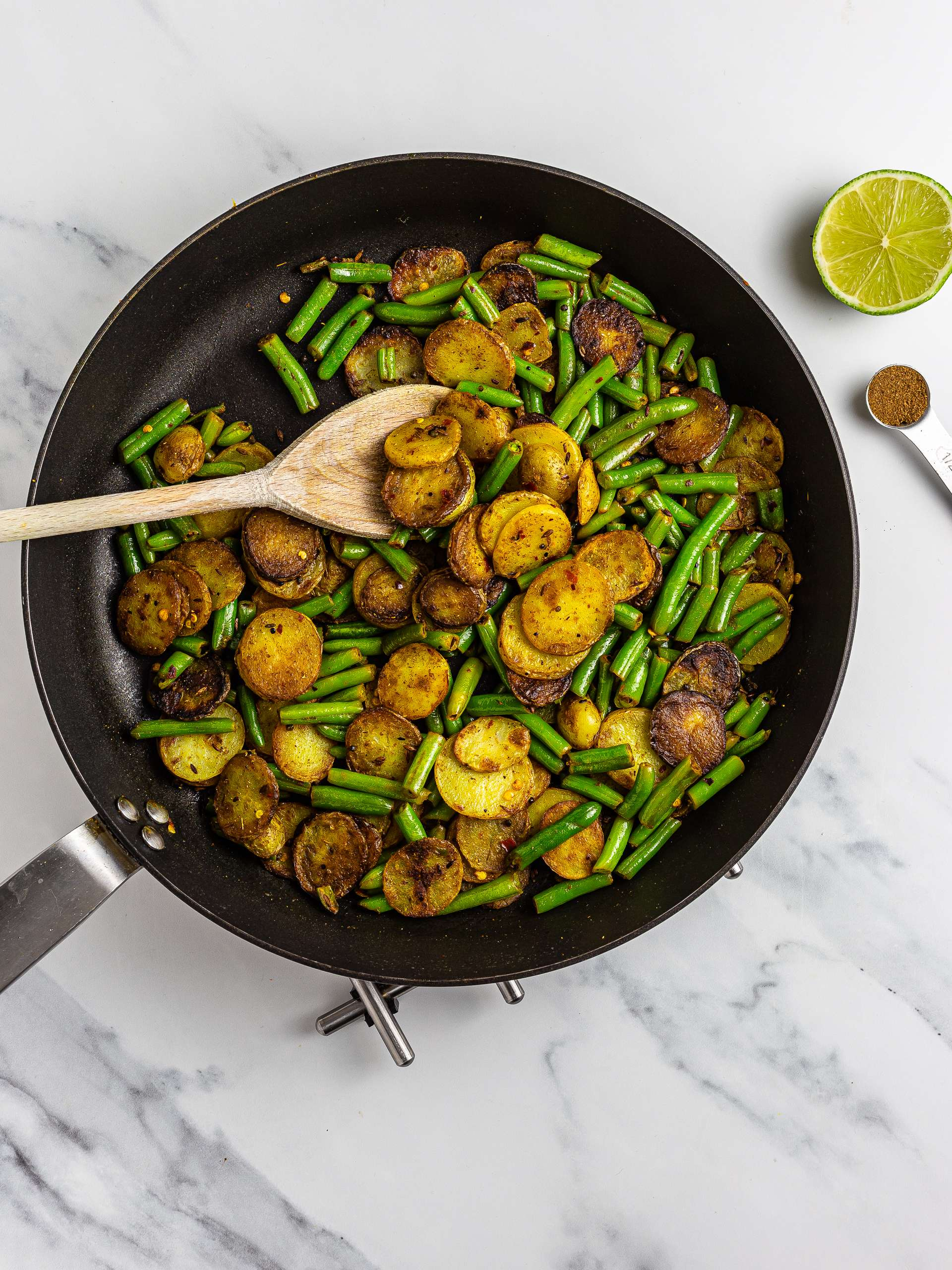 Aloo green beans Indian stir-fry with masala and lime