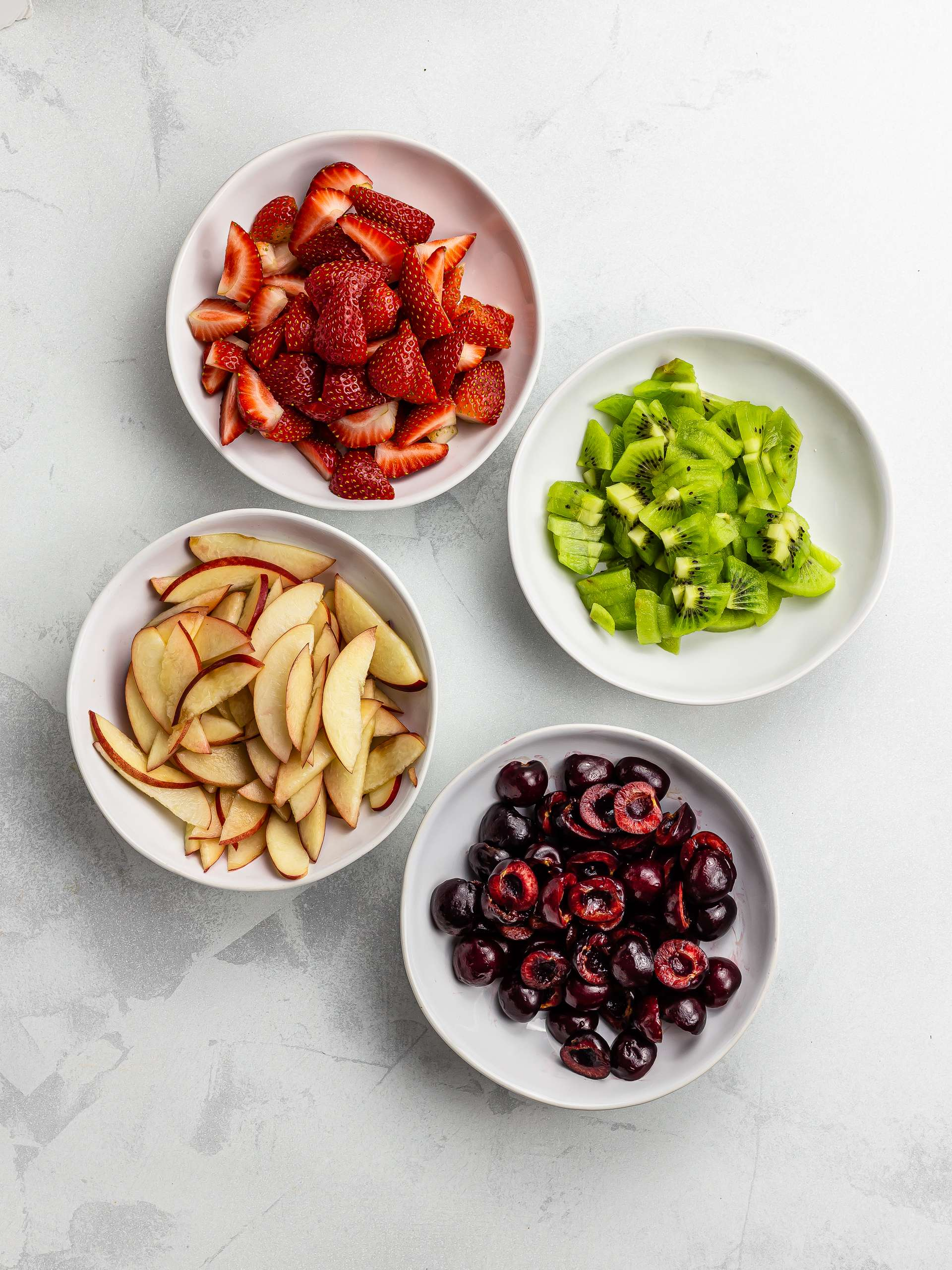 chopped summer fruit in a bowl